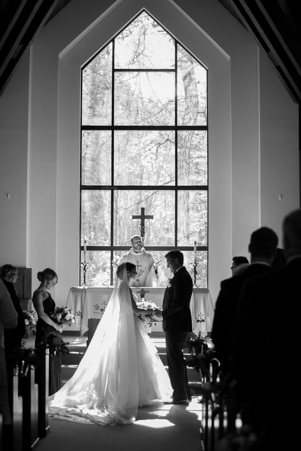 Bride and groom in beaver creek wedding chapel