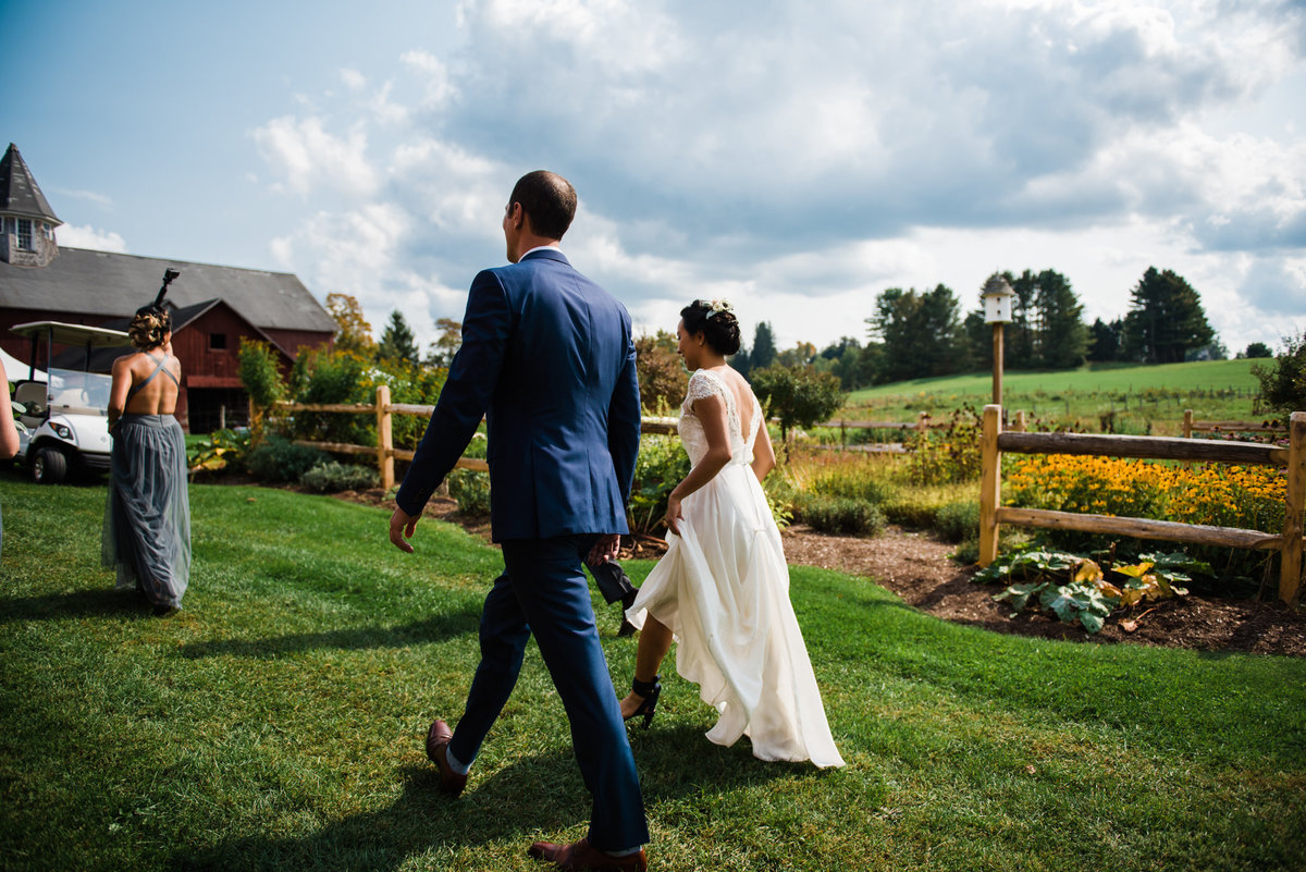 bride and groom walking photo, Vermont wedding photographer