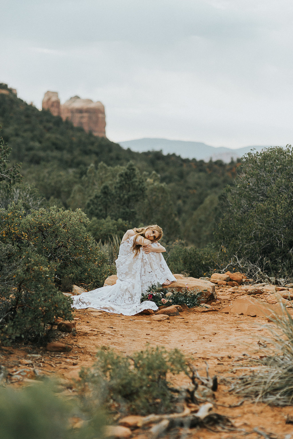 Bell Rock in Sedona Arizona serves as a focal point in this bridal portrait in Sedona Arizona.