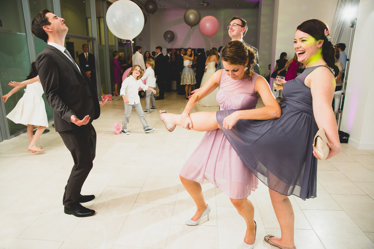 bridesmaid plays leg as a guitar with funny dancing photo
