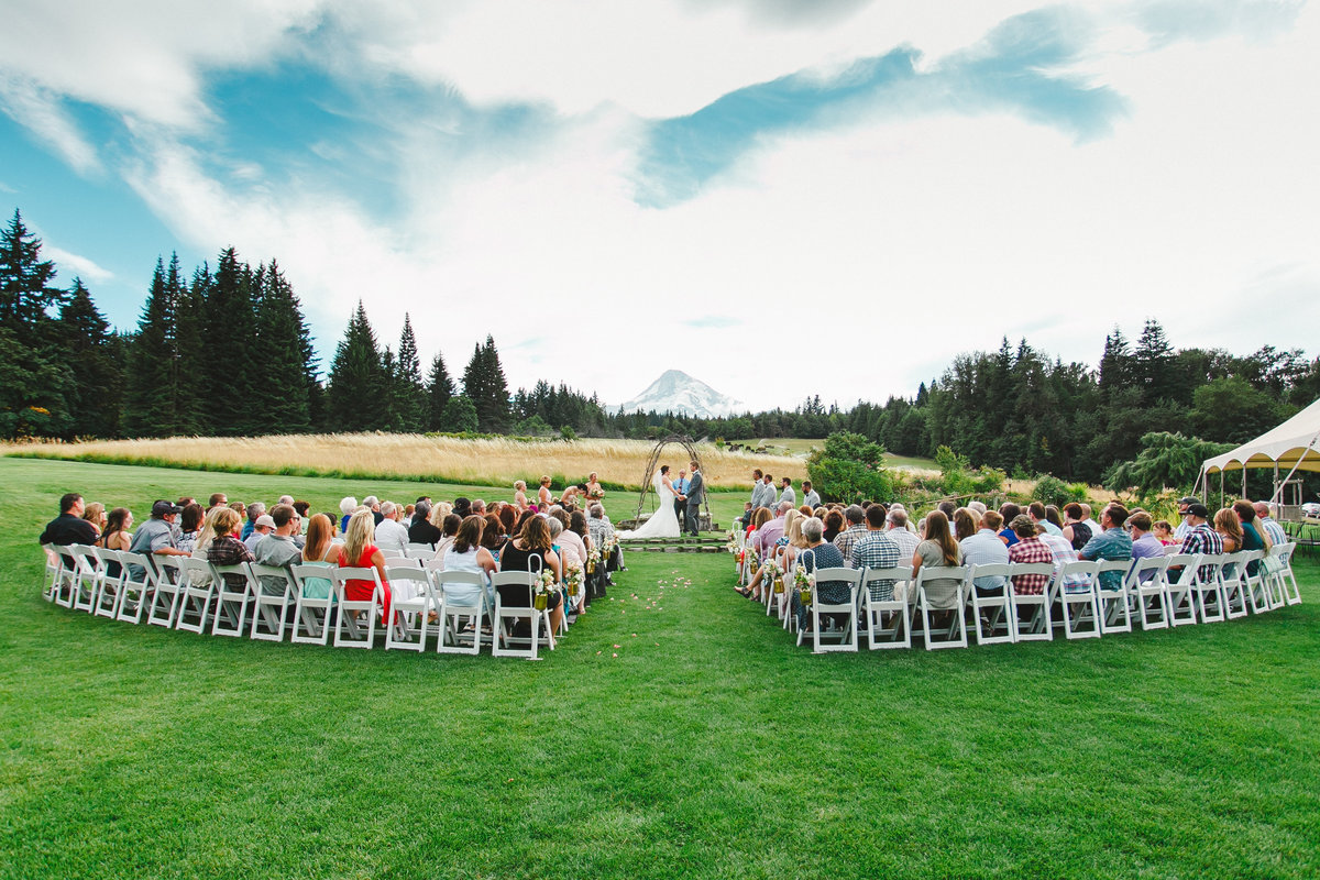 photo of outdoor wedding ceremony overlooking Mt. Hood at Mt. Hood bed and breakfast in Oregon  | Susie Moreno Photography