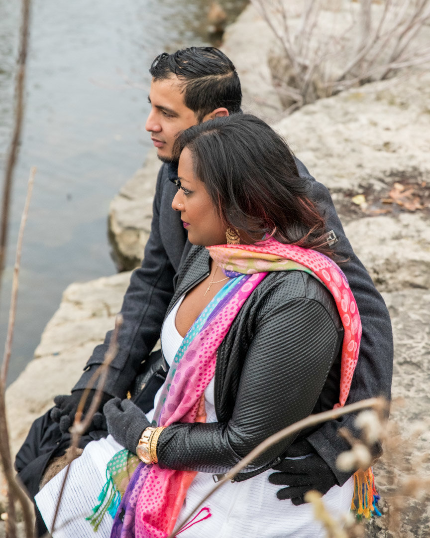 Couple sitting together in front of the duck pond at Chinguacousy Park Brampton for Couples Portraits