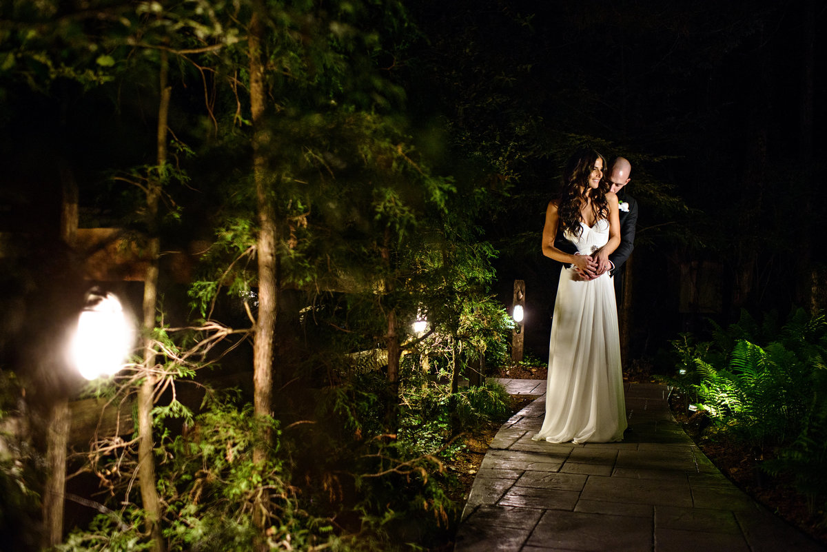A bride and groom holding each other right outside of their reception at Holly Hedge Estate.