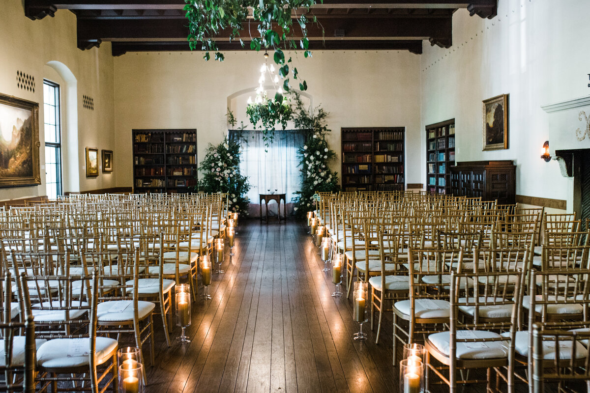 wedding ceremony with candles greenery and flowers