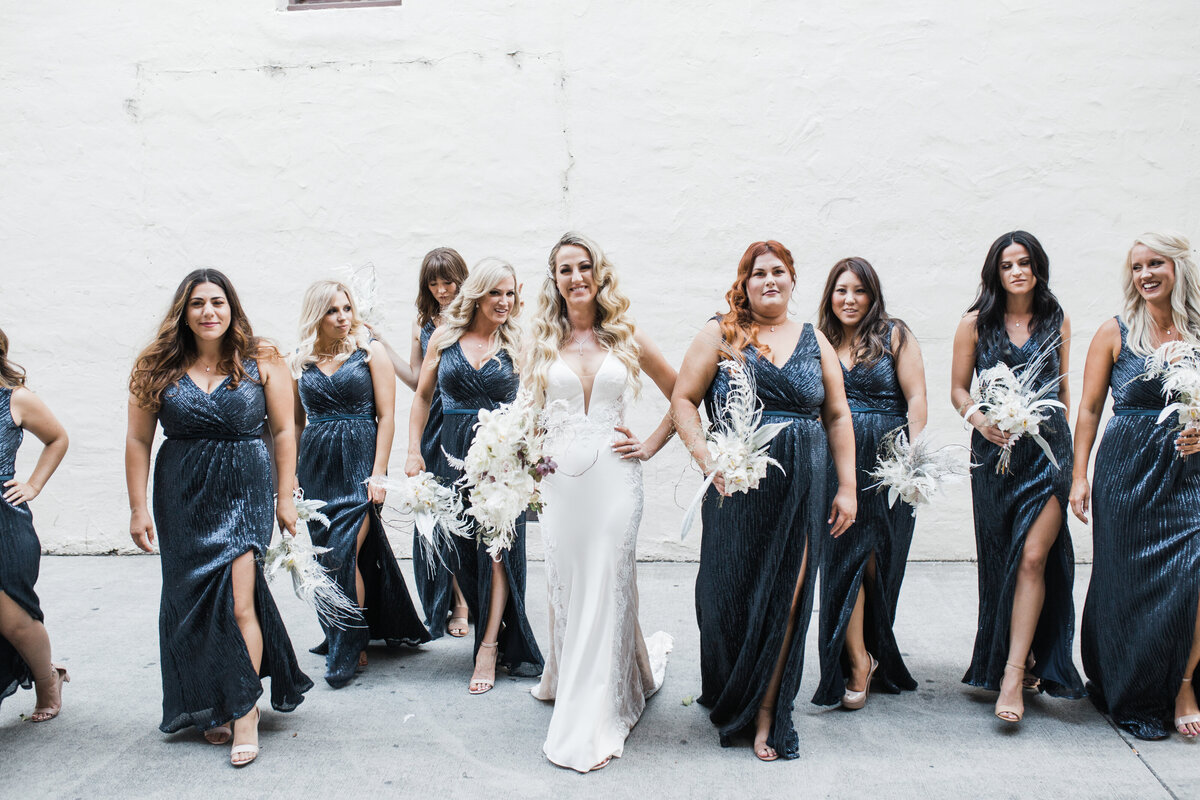 bride and bridesmaids holding white bouquets