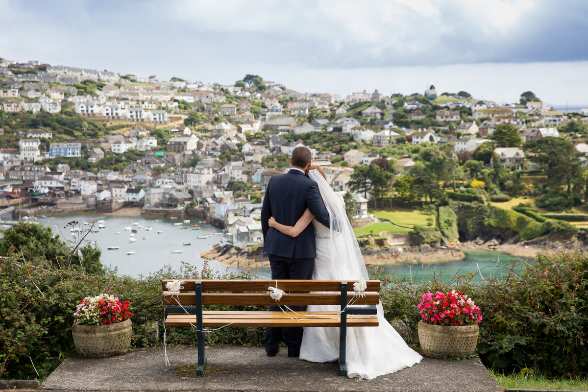 bride and groom overlooking fowey in cornwall on their wedding day