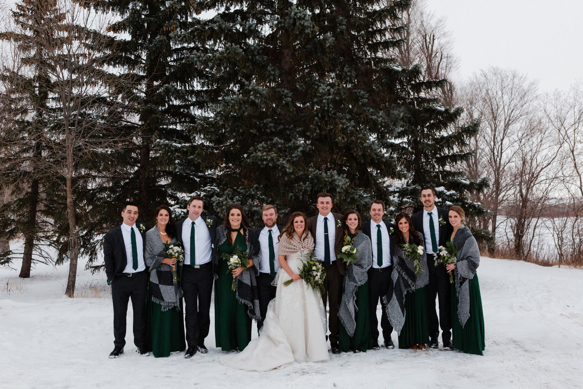 Winter bridal party photos in November. Snowy Bridal Party Photos