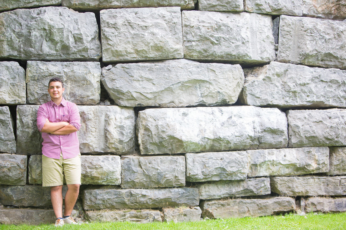 senior portrait by big stone wall