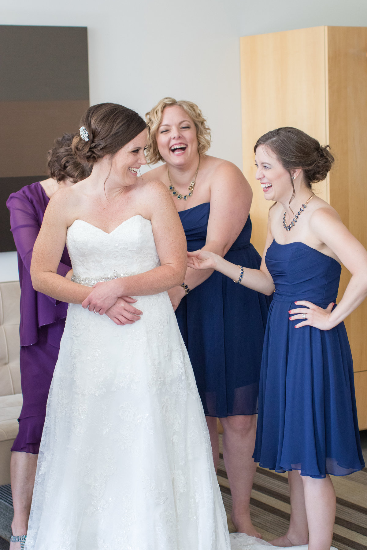candid-bridesmaid-getting-ready-picture-wedding-photographer-chicago-aurora-photo