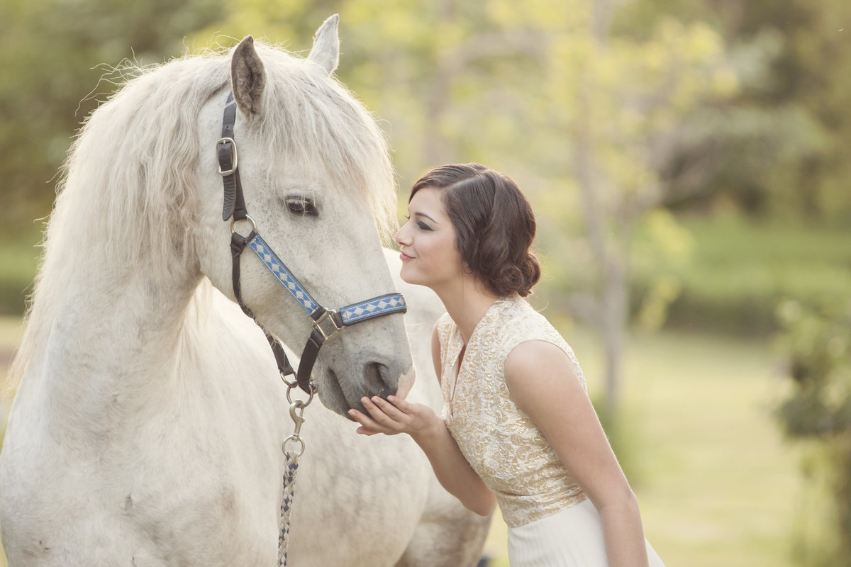 Beautiful bride with horse bridal white horse equestrian by Casi Lea Photography-green bay wedding photographer-door county wedding photographer-milwaukee wedding photographer-appleton wedding photographer-wisconsin weddings