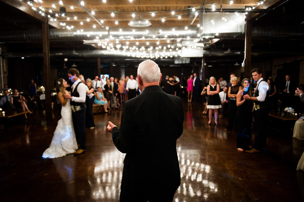 Priest singing at Chicago wedding, Morgan Manufacturing.