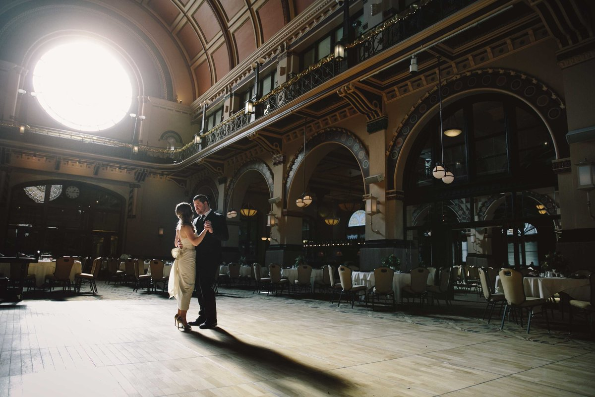 Couple dances in the middle of union station crowne plaza wedding