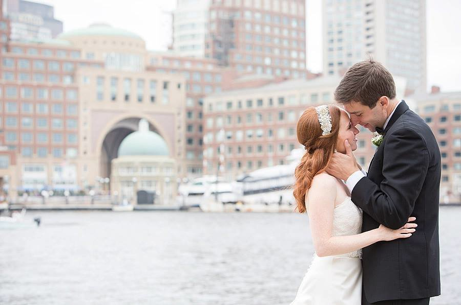 boston harbor hotel wedding couple with skyline background