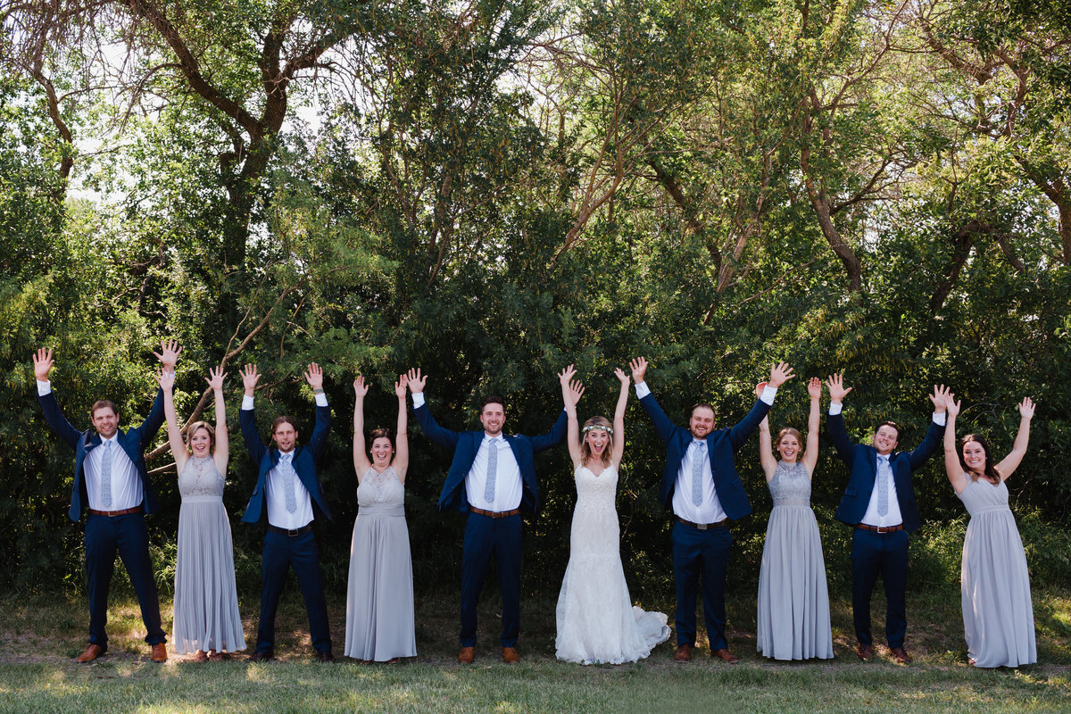 Fun bridal party photos excited on a hot summer's day wedding.