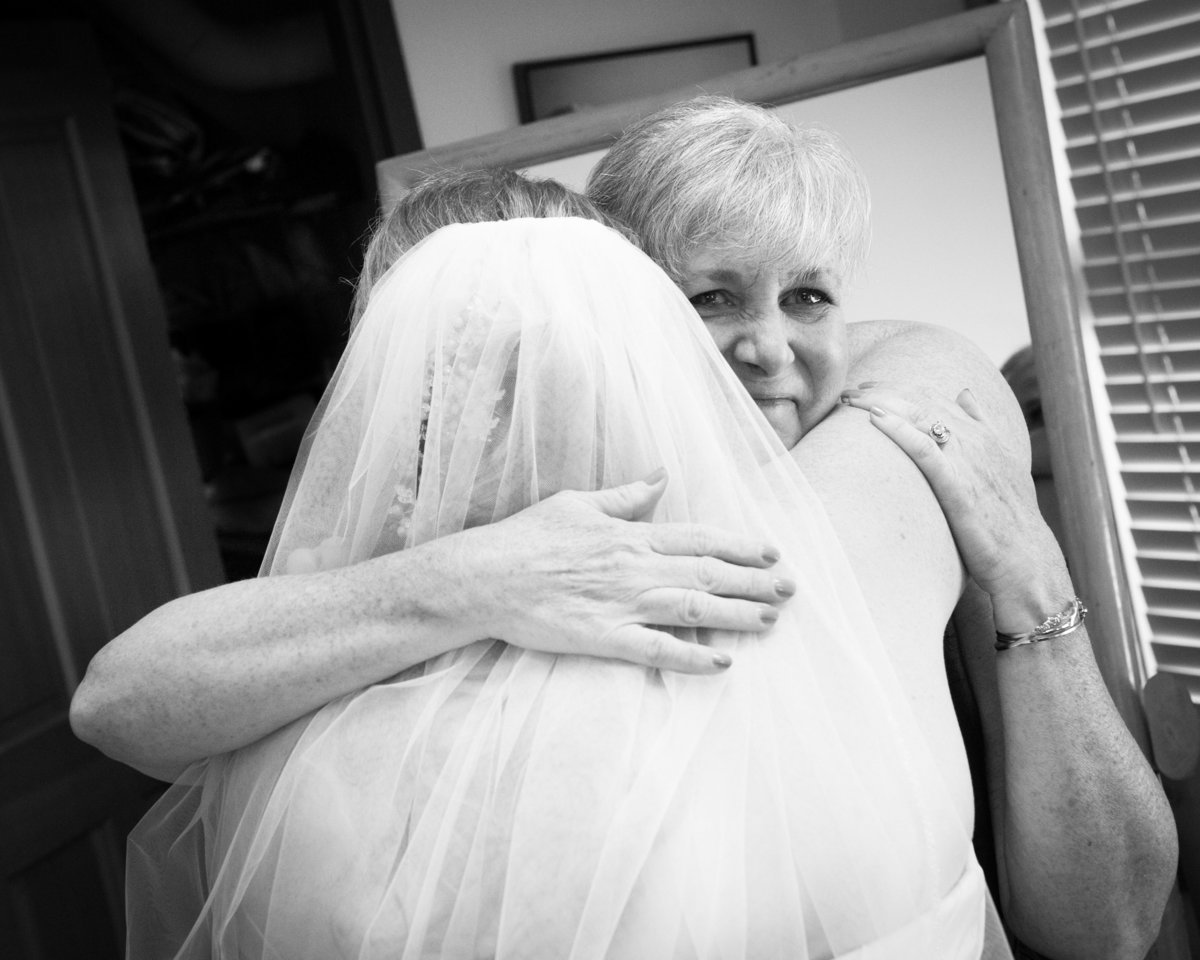 Mother hugs daughter bride, wedding, Park City Utah.
