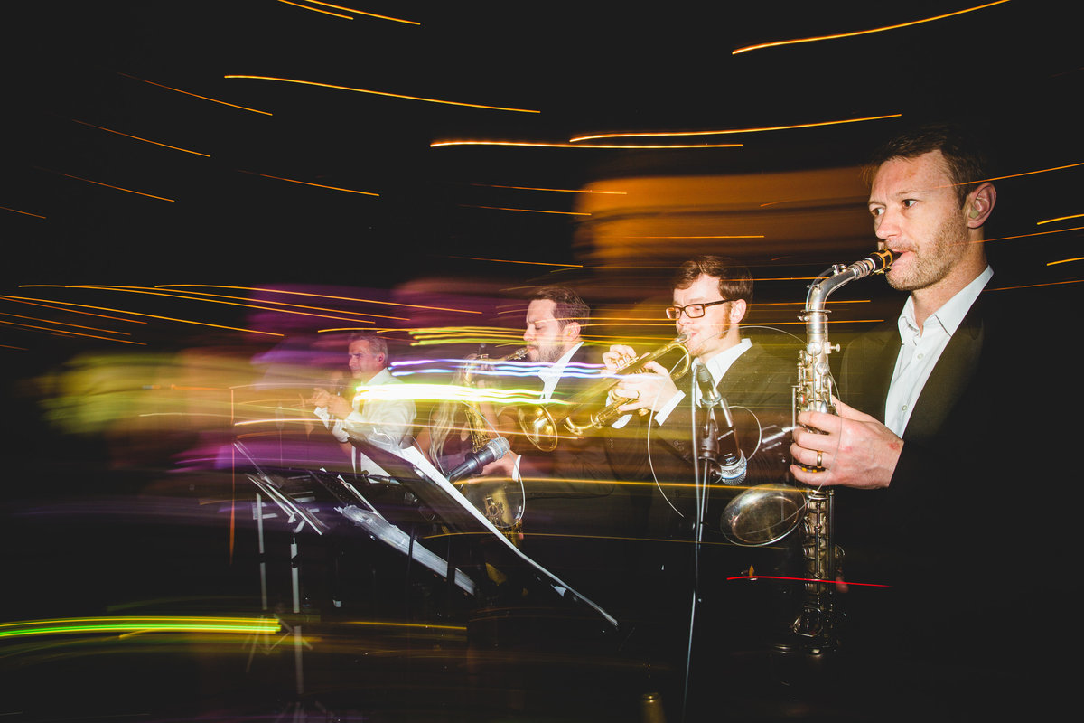 brass band playing at a wedding long exposure