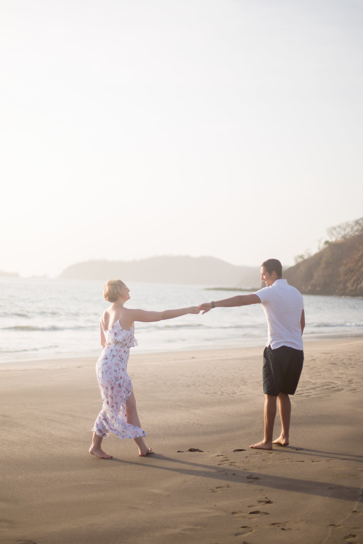 Bride and groom dancing on a beach in Costa Rica