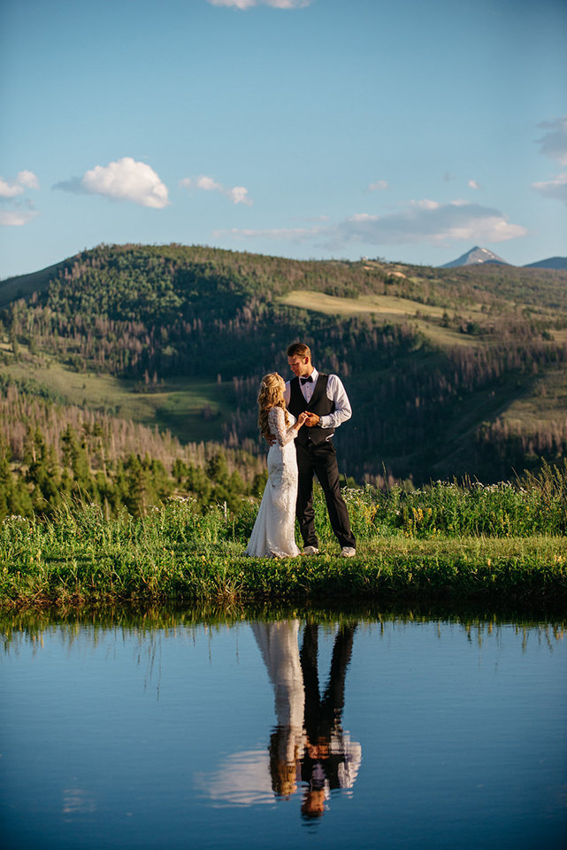 Strawberry-Creek-Ranch-Modern-Minimalist-Outdoor-wedding-in-Granby-Colorado-Embraced-next-to-pond