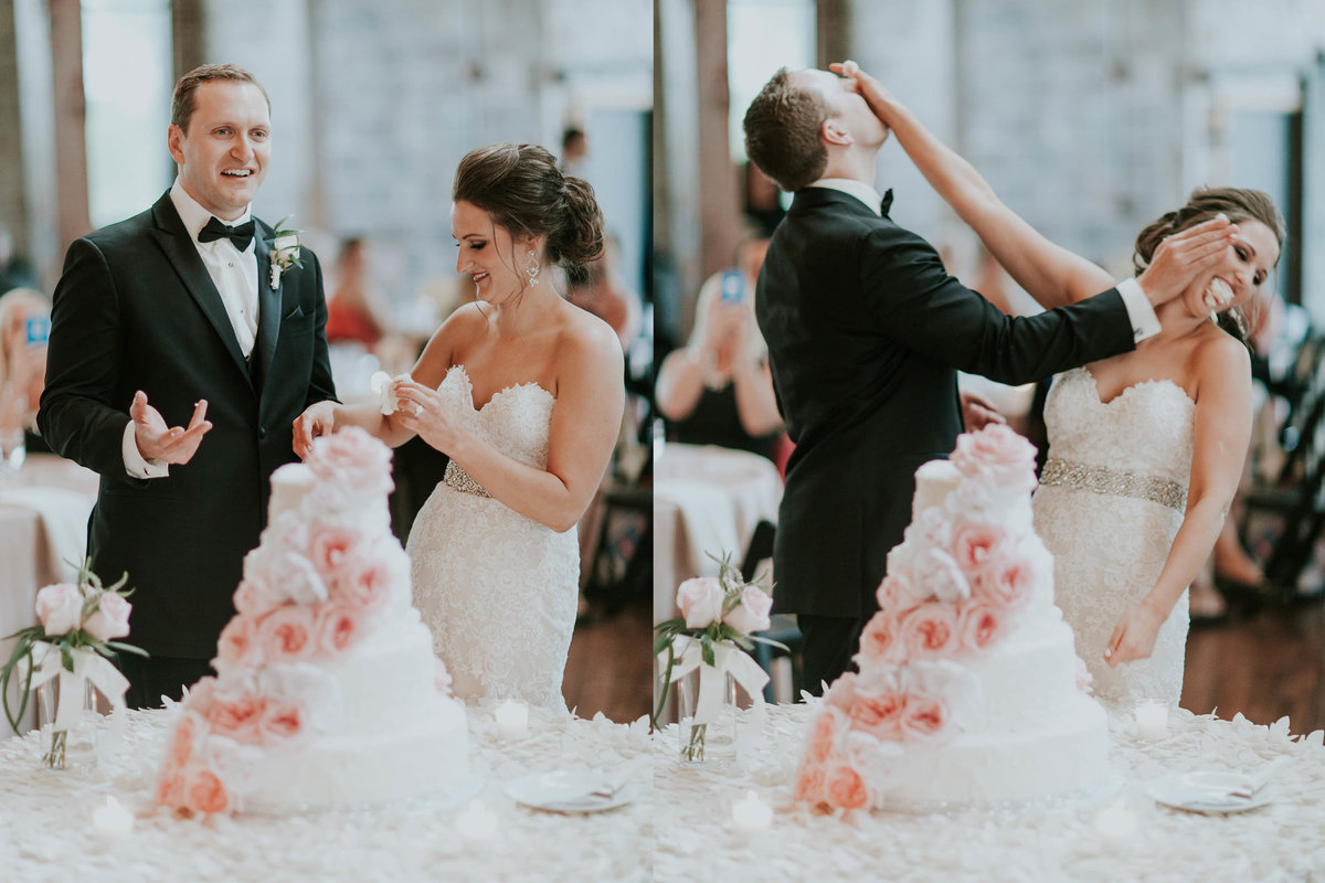 Bride and groom smash cake into each others face at Biltwell center wedding