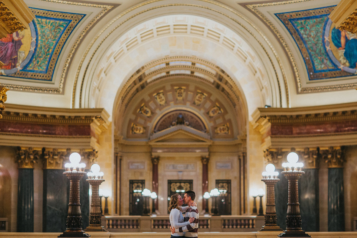 couple kissing at the madison wisconsin capitol building  during their engagement phiotographs