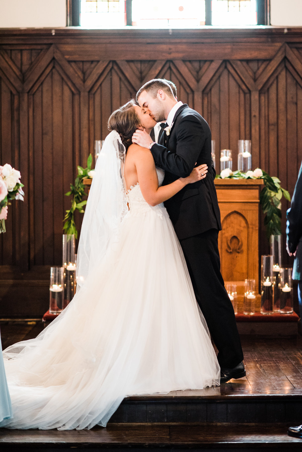 all saints chapel wedding ceremony kiss photo