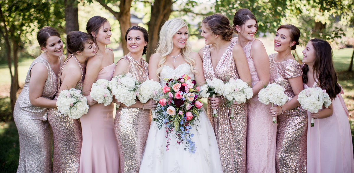 Bride and all her bridesmaids at a park in Louisville, KY by Knoxville Wedding Photographer, Amanda May Photos.
