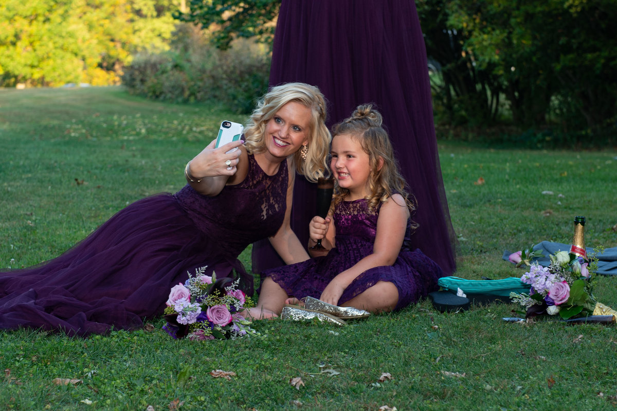 selfie on the lawn with purple dresses