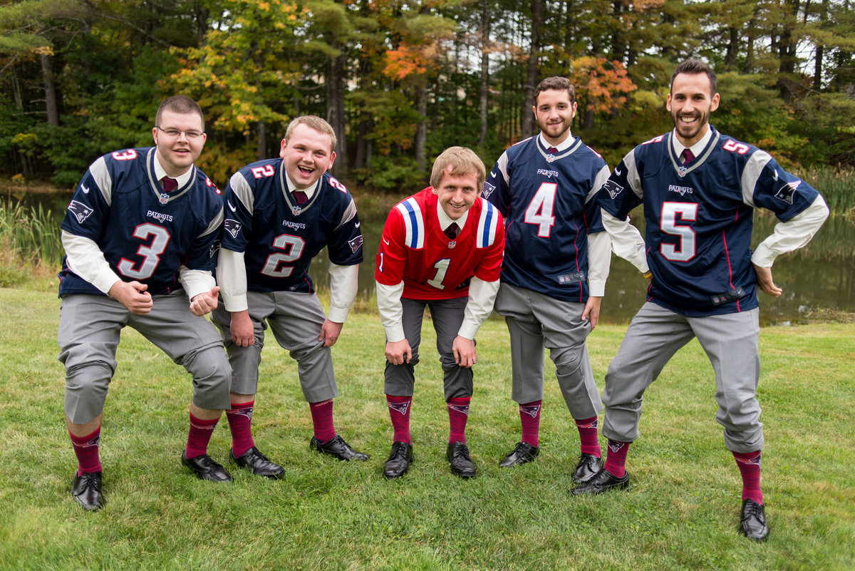 groomsmen wearing football jerseys