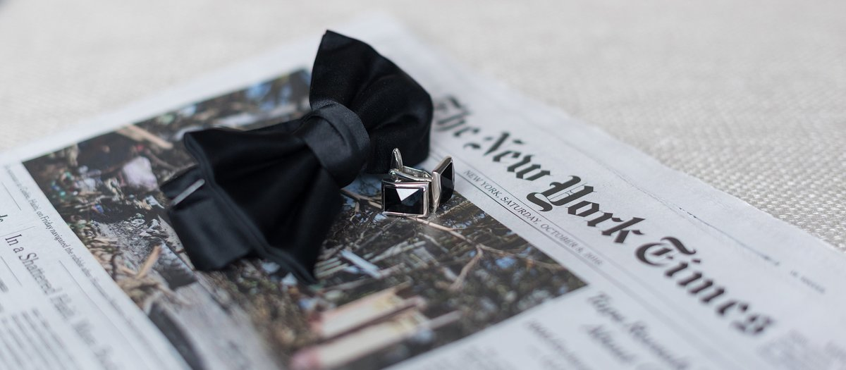 Groom's bowtie and cufflinks on The New York Times photo