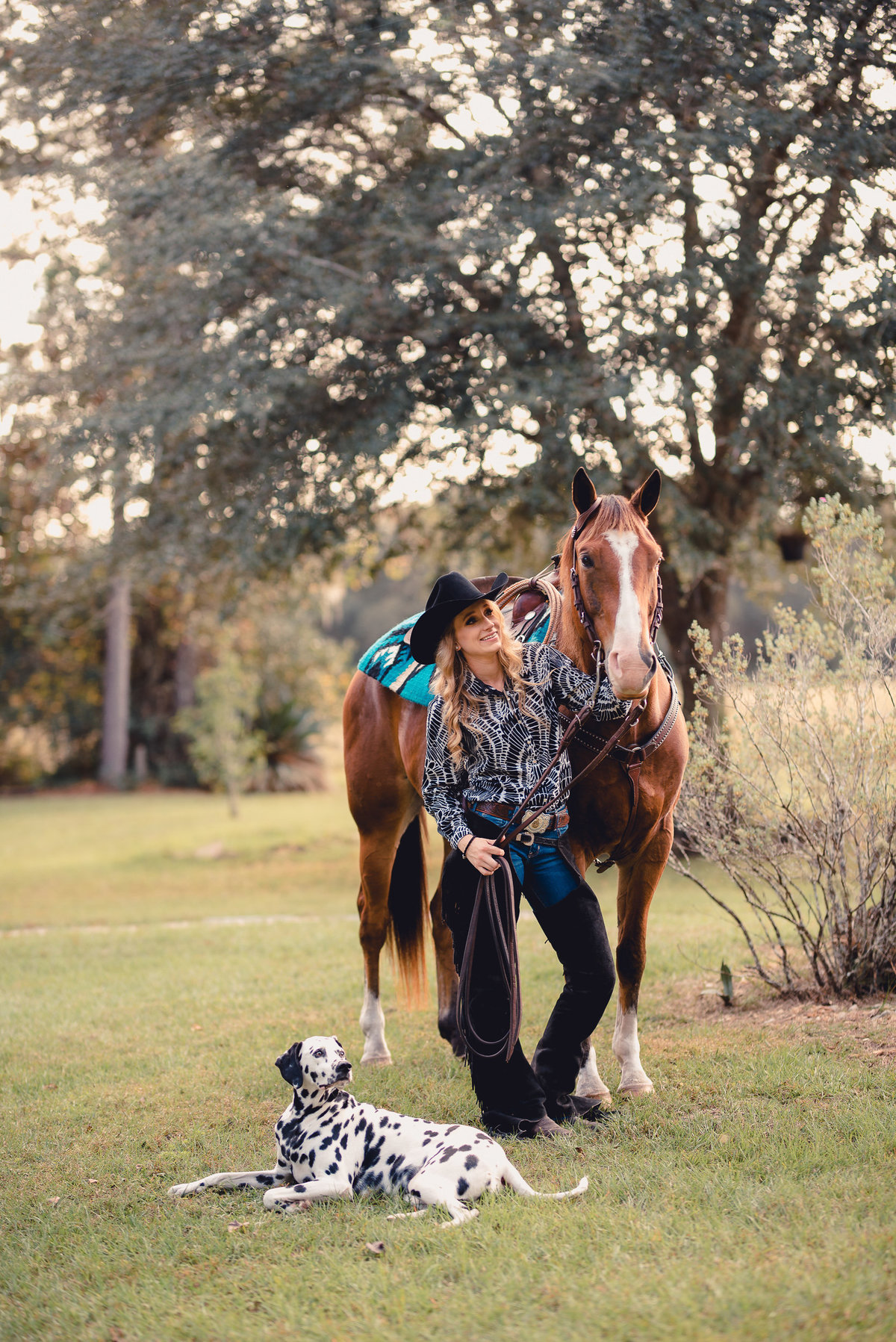Girl with her horse and dog in ranch riding attire in Ocala, FL