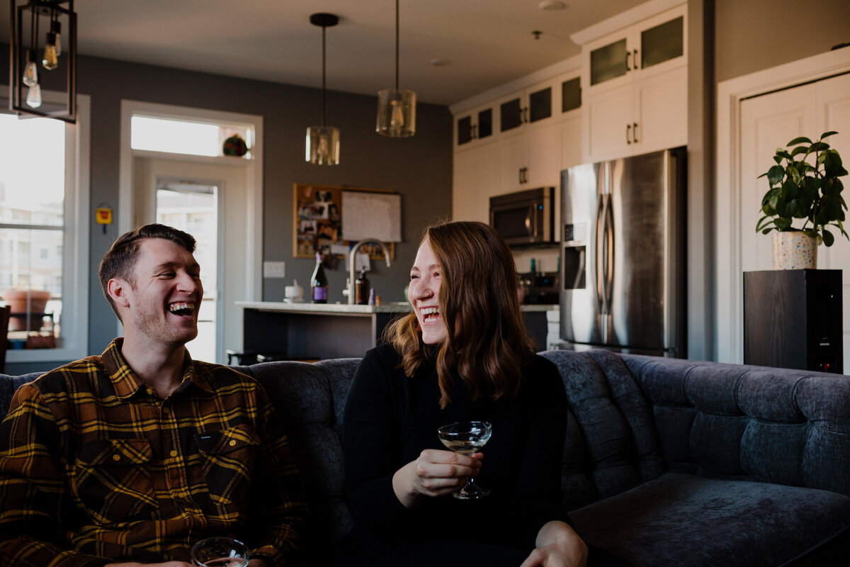 Couple drinking champagne on couch