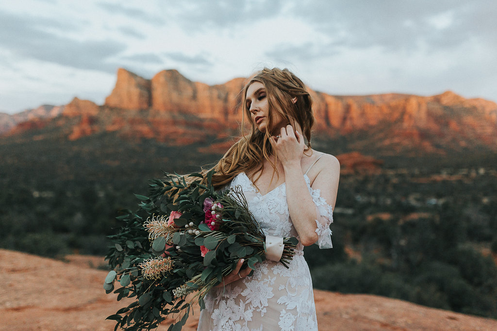 Sedona elopement bride takes in the feeling of her elopement day during sunset in Arizona.