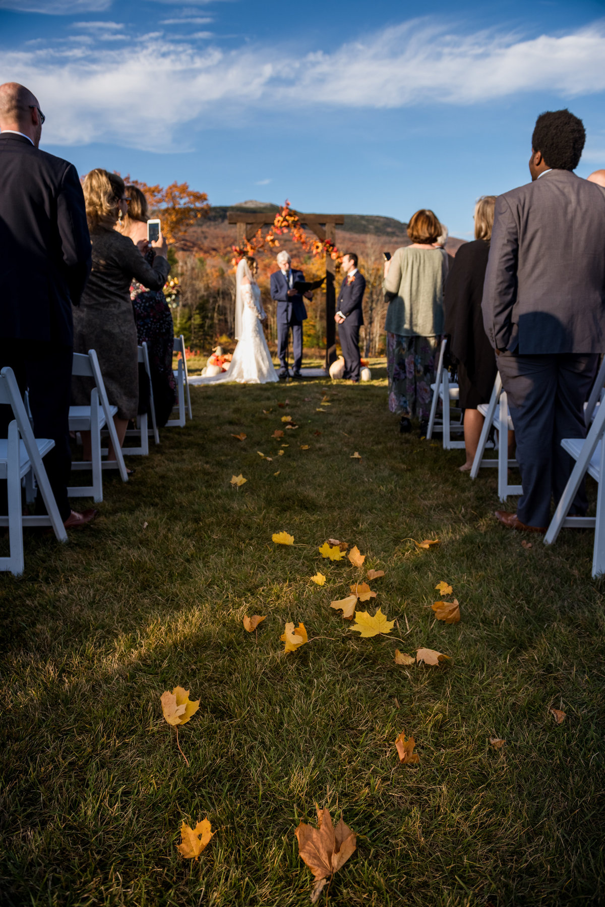 leaves on the ground during fall wedding in outdoor venue NH