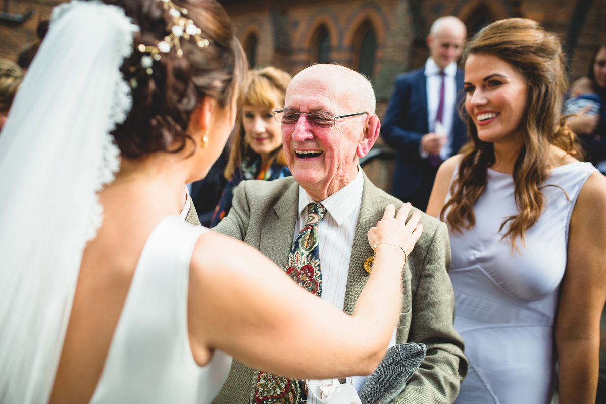 bride congratulated by grandad after wedding ceremony. grandad worked at bletchley park