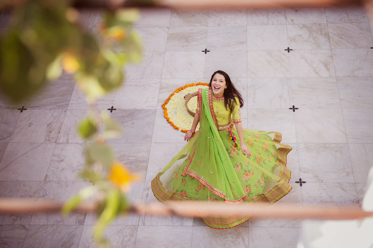 Twirling away happily in her floral lehenga