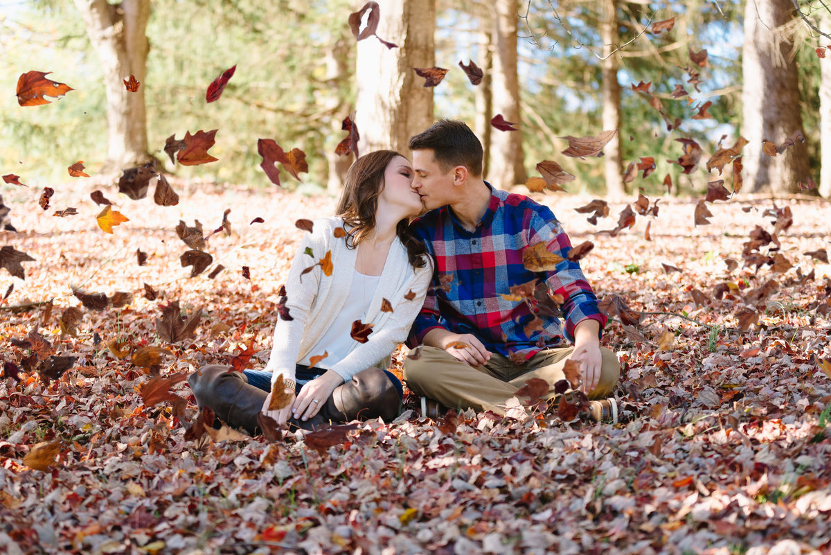 meadowlark botanical gardens engaged couple in fall leaves
