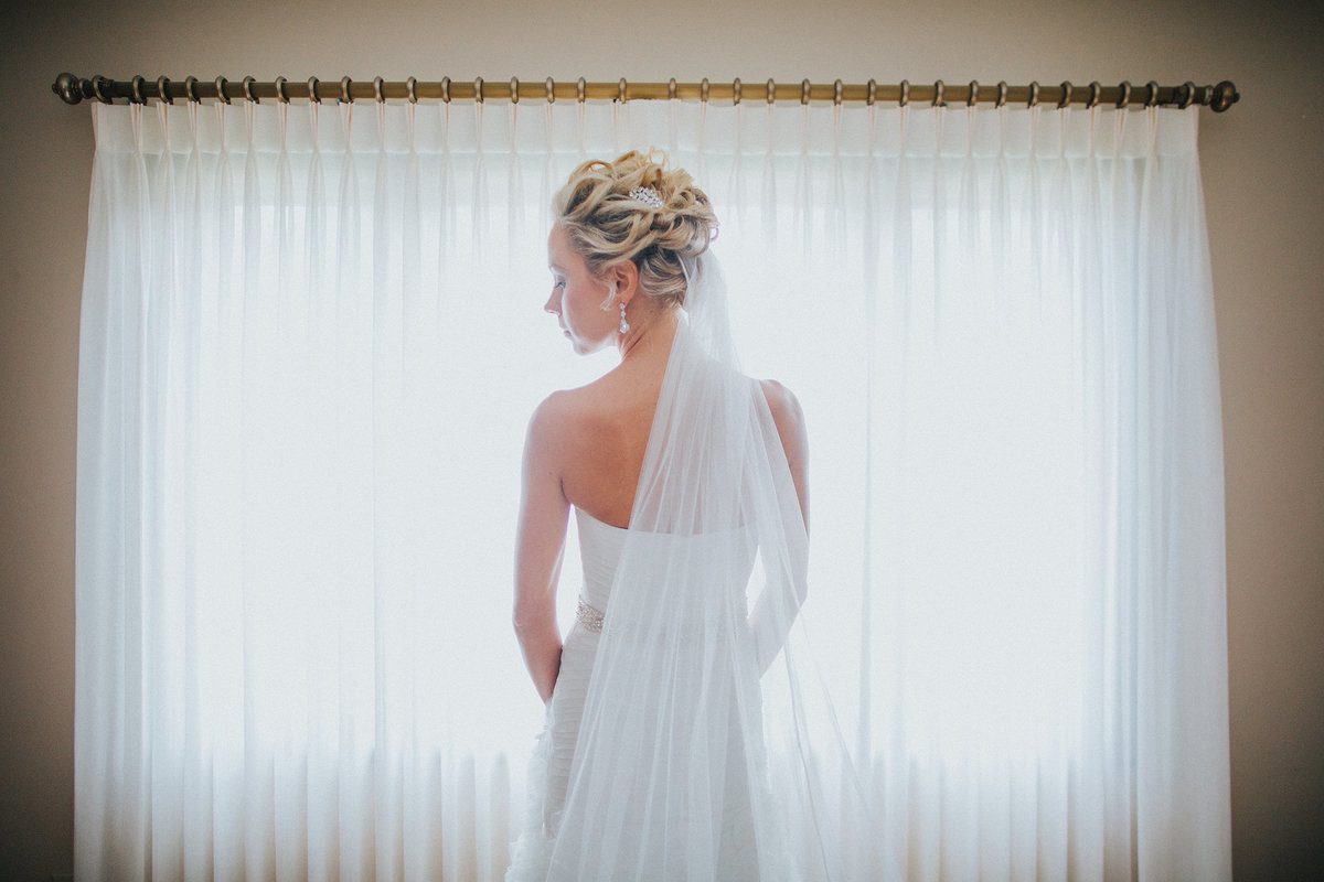 clean portrait of bride and her veil