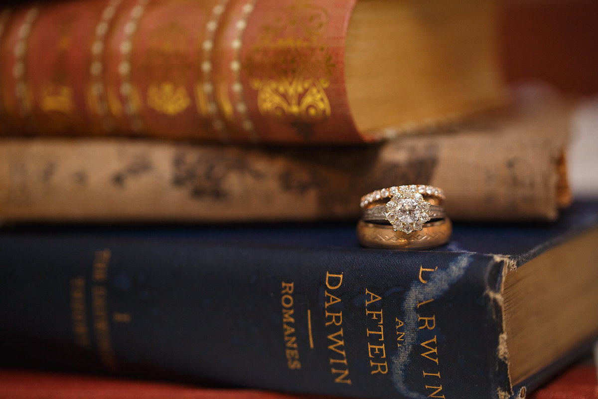 Wedding rings on books creative shot
