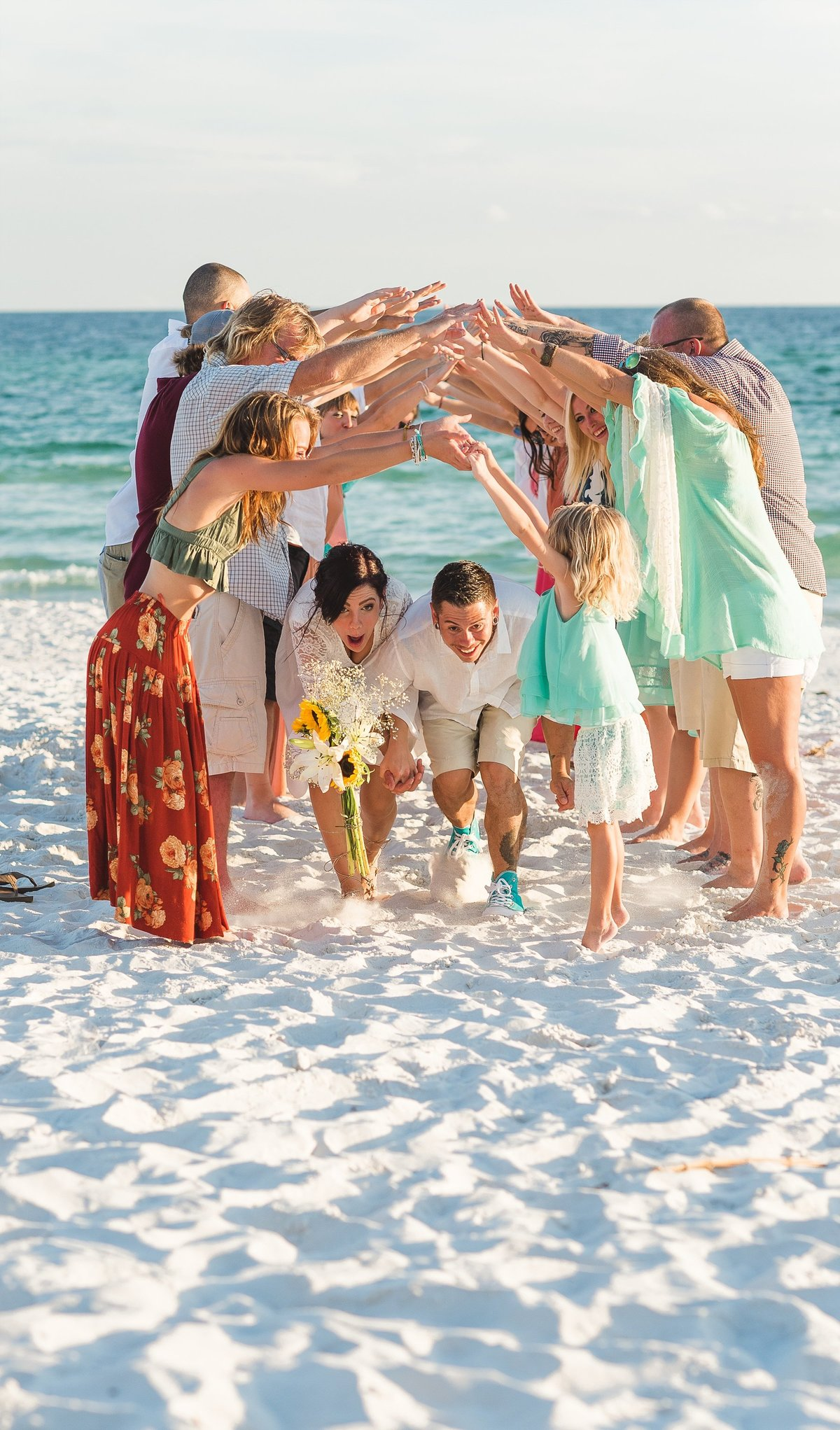 Miss Morse Photography, Pcb photographer, 30A Wedding photographer, Destin wedding photographers, Destin photography, Florida wedding photographers, Miramar beach wedding, Beach wedding photographer, photo of bride and groom going through tunnel