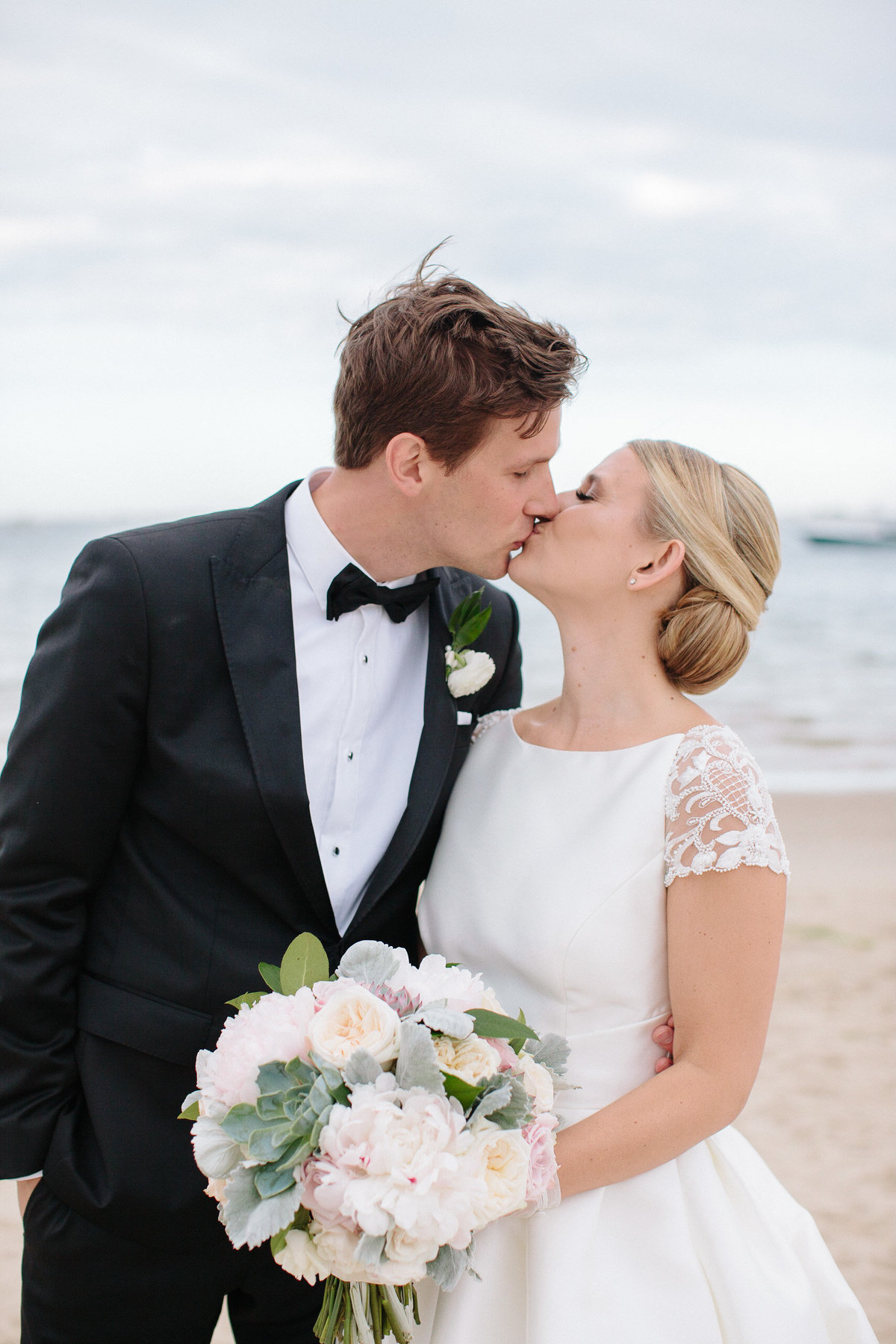 Bride and groom beach portraits summer wedding