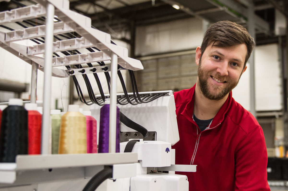 man at embroidery machine profiling position