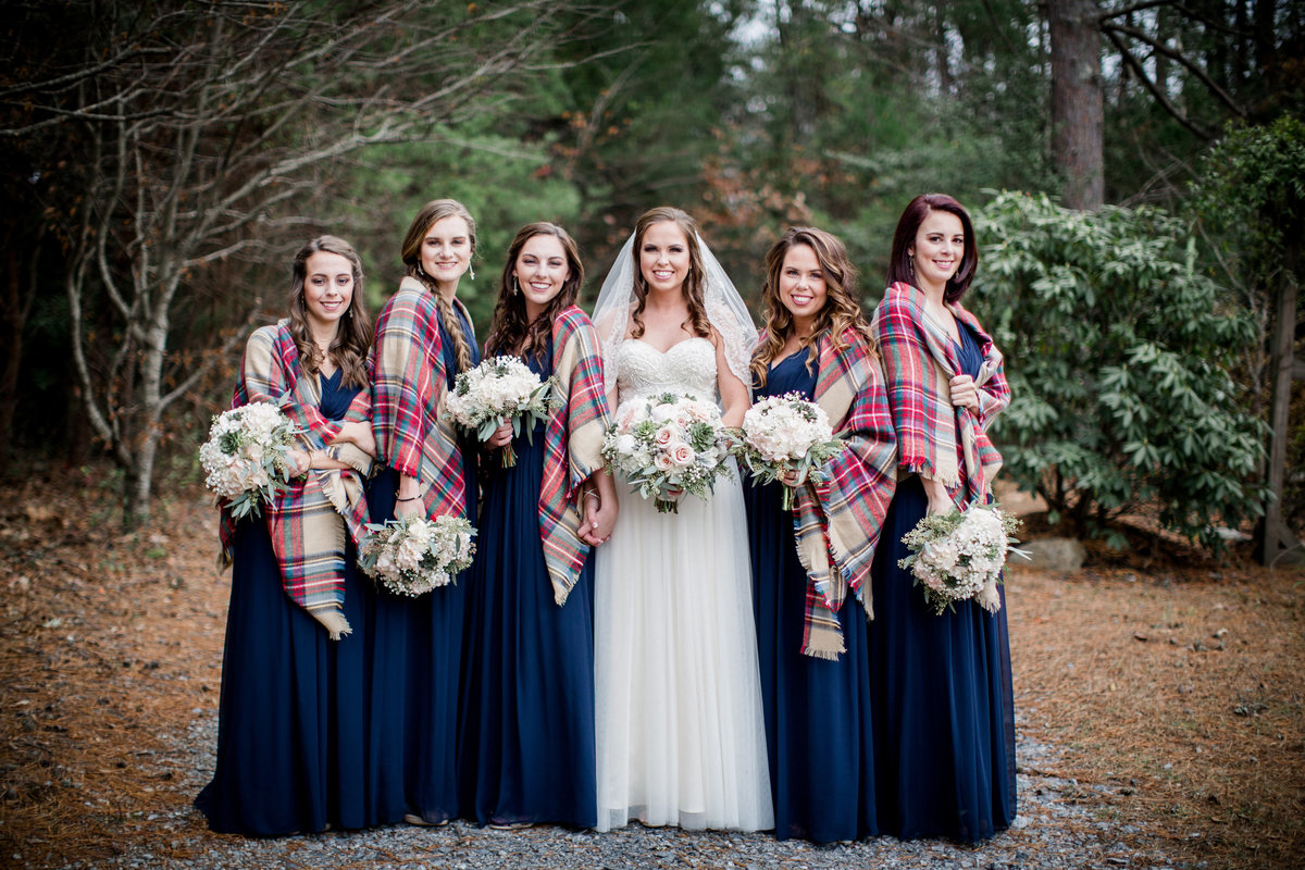 Bride and bridesmaids during winter wedding with plaid blanket scarves at Sampson's Hollow Wedding Venue by Knoxville Wedding Photographer, Amanda May Photos.