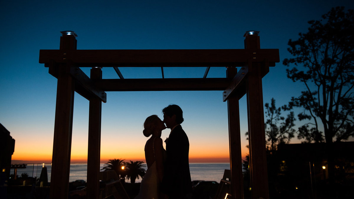 Couple-kiss-on-wedding-day-silhouette-at-Luberge-Del-Mar-CA-