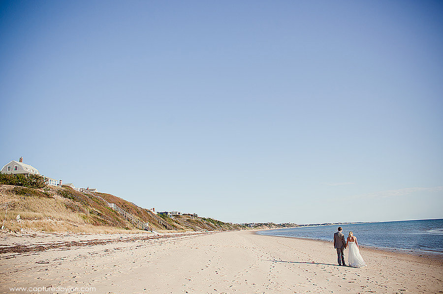 cape code wedding couple walking on beach