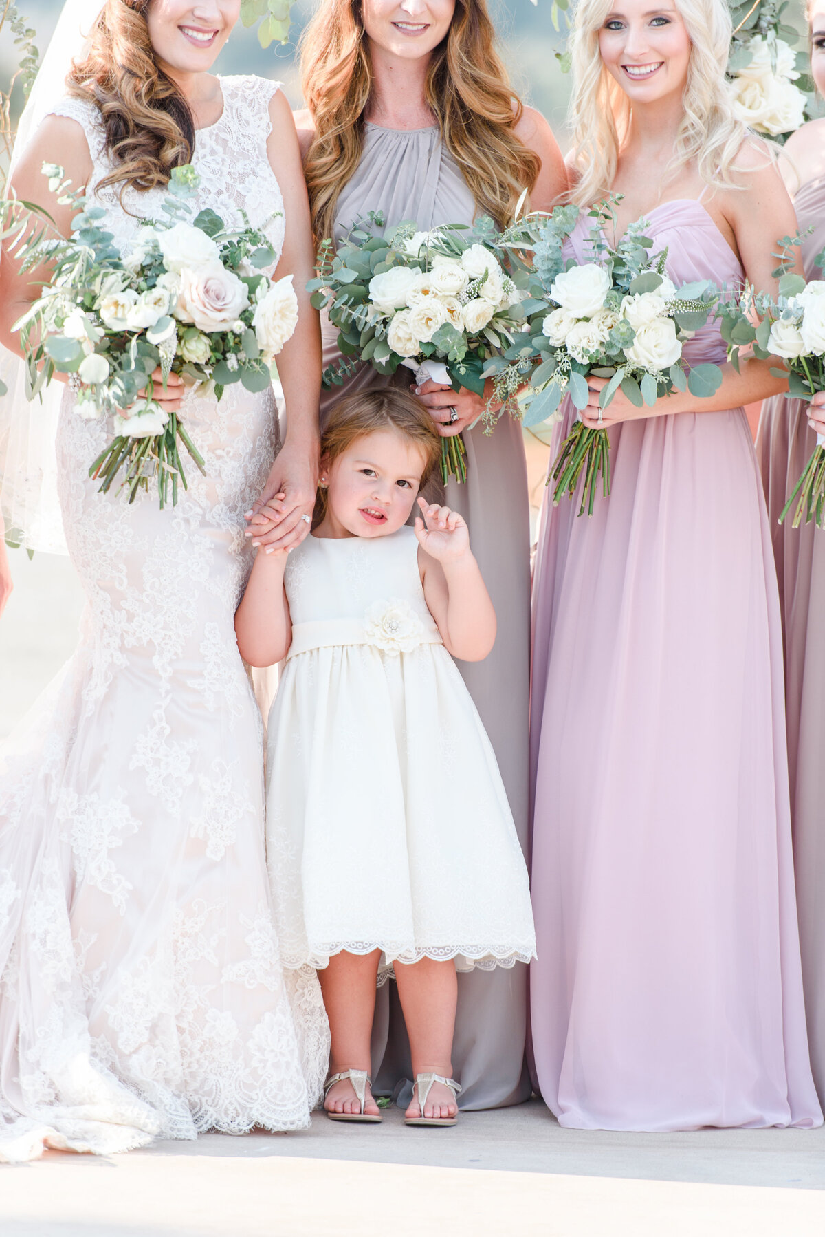 bridal party holding flower bouquet
