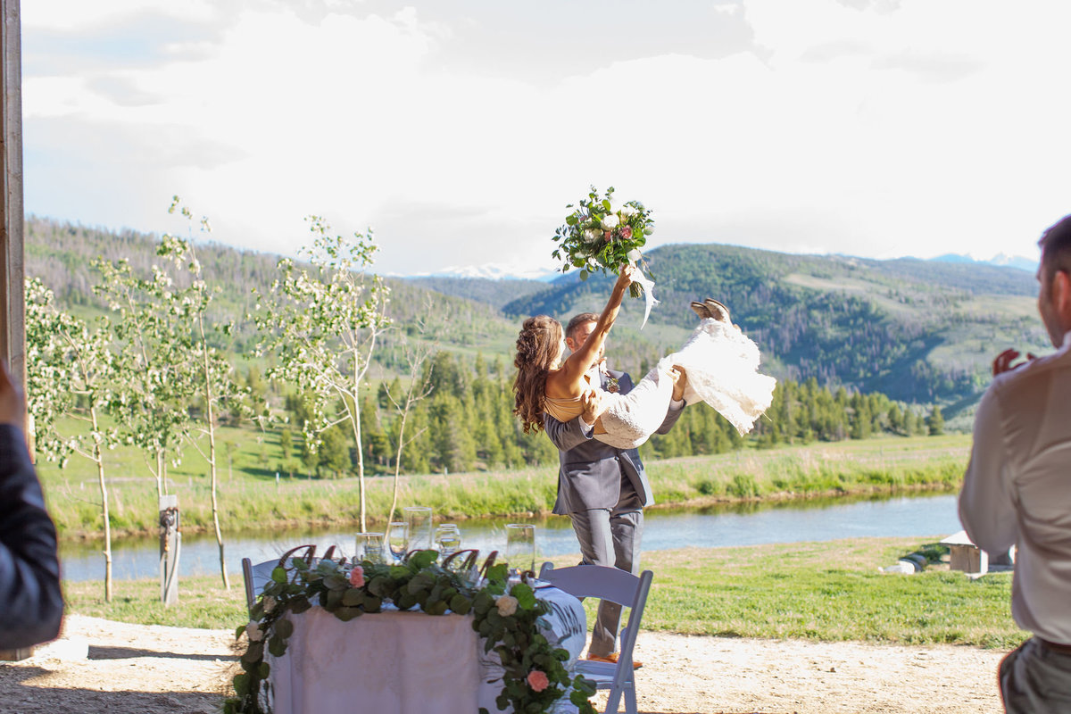 Strawberry-Creek-Ranch-Wedding-Ashley-McKenzie-Photography-Summer-love-on-the-ranch-Groom-carries-bride