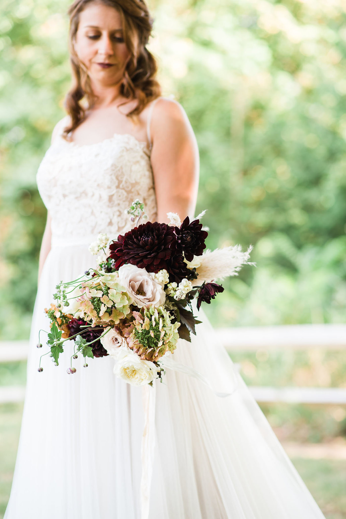 bride with organic wedding bouquet