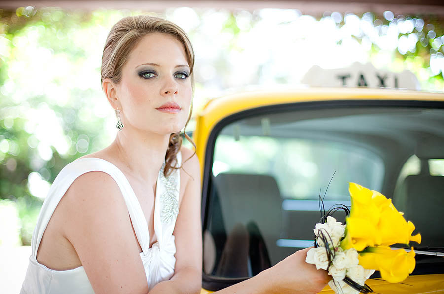 moder wedding with bride leaning on taxi