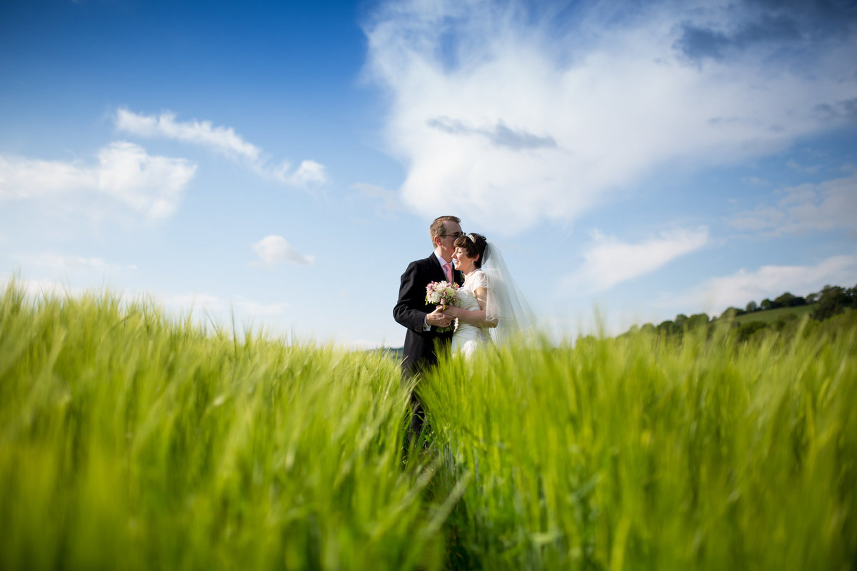 bride-and-groom-in-a-field-devon