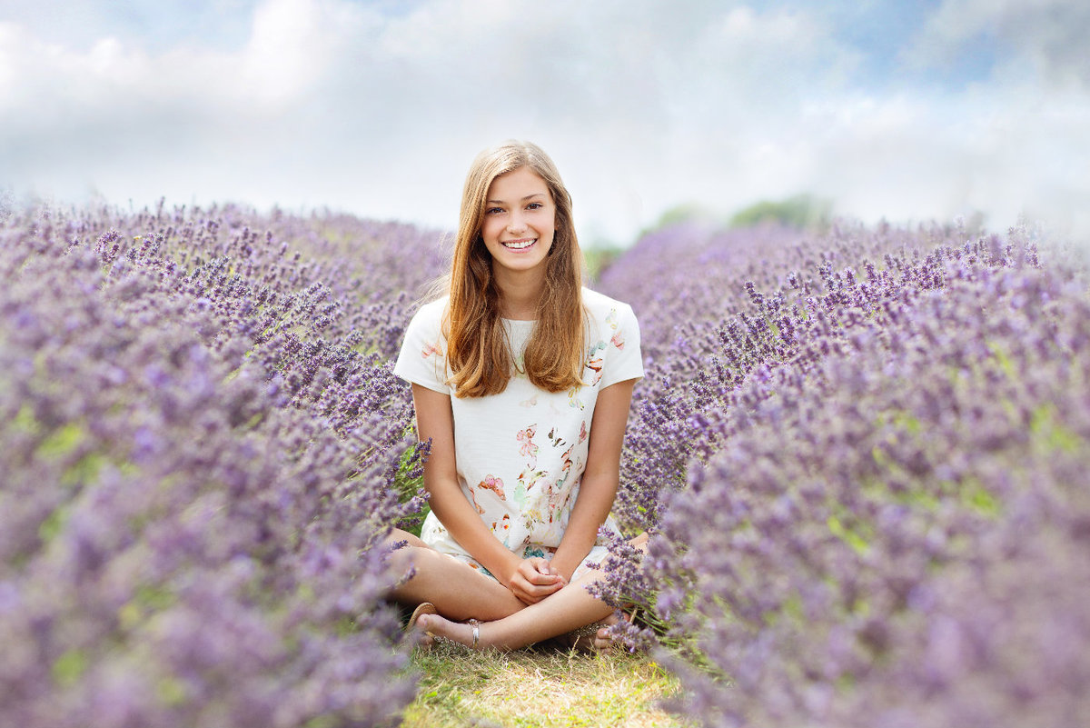 young girl sitting in lavender field